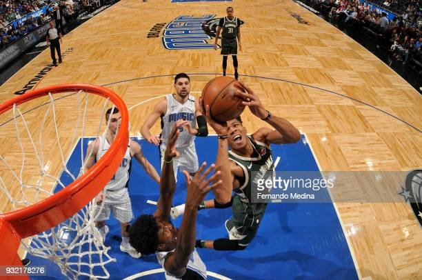 Giannis Antetokounmpo of the Milwaukee Bucks shoots the ball against the Orlando Magic on March 14 2018 at Amway Center in Orlando Florida NOTE TO...