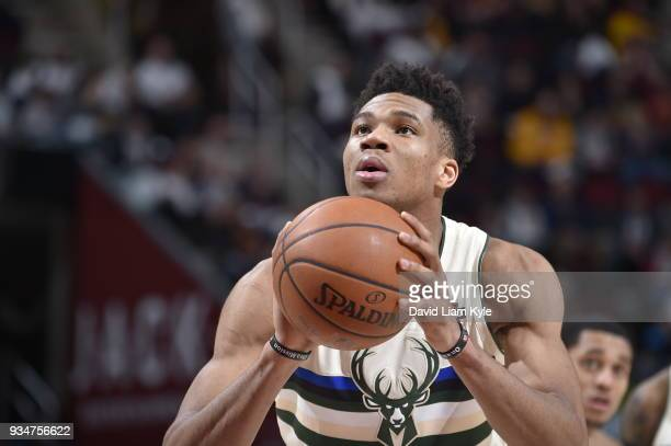 Giannis Antetokounmpo of the Milwaukee Bucks shoots the ball against the Cleveland Cavaliers on March 19 2018 at Quicken Loans Arena in Cleveland...