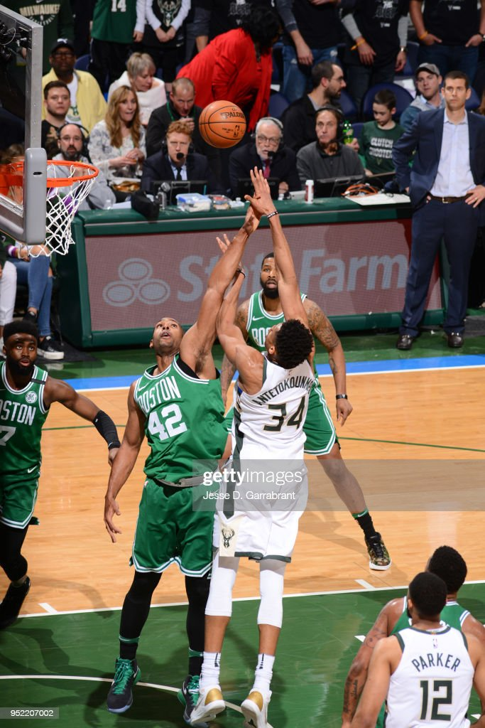 Giannis Antetokounmpo #34 of the Milwaukee Bucks shoots the ball against Al Horford #42 of the Boston Celtics in Game Six of Round One of the 2018 NBA Playoffs on April 26, 2018 at the BMO Harris Bradley Center in Milwaukee, Wisconsin.