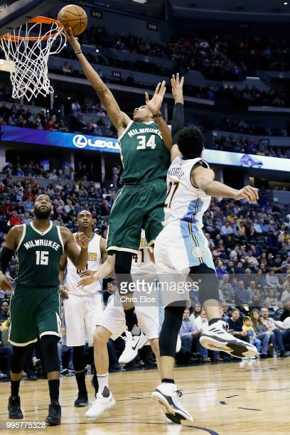 Giannis Antetokounmpo of the Milwaukee Bucks shoots the ball against the Denver Nuggets on February 3 2017 at the Pepsi Center in Denver Colorado...