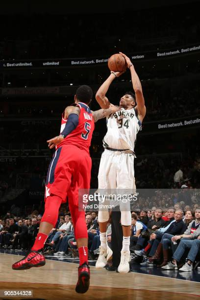 Giannis Antetokounmpo of the Milwaukee Bucks shoots the ball during the game against the Washington Wizards on January 15 2018 at Capital One Arena...