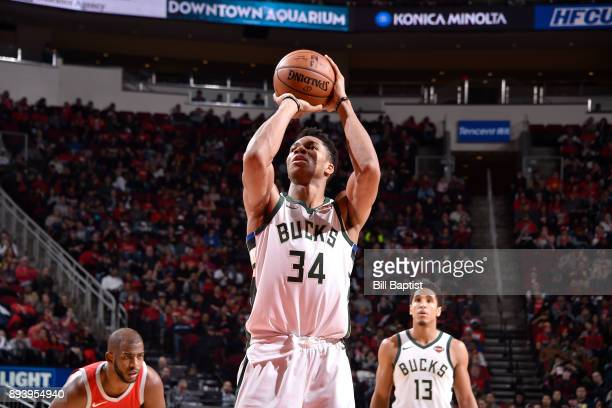 Giannis Antetokounmpo of the Milwaukee Bucks shoots the ball from the freethrow line against the Houston Rockets on December 16 2017 at the Toyota...