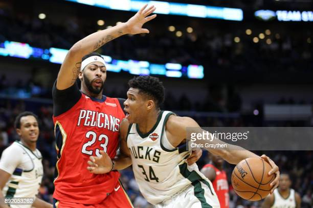 Giannis Antetokounmpo of the Milwaukee Bucks shoots the ball over Anthony Davis of the New Orleans Pelicans at Smoothie King Center on December 13...