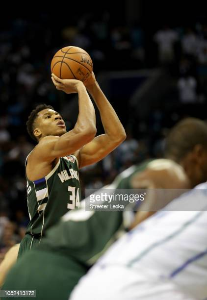 Giannis Antetokounmpo of the Milwaukee Bucks shoots the game winning free throw against the Charlotte Hornets during their game at Spectrum Center on...