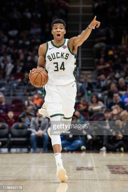Giannis Antetokounmpo of the Milwaukee Bucks signals to teammates during the second half against the Cleveland Cavaliers at Quicken Loans Arena on...