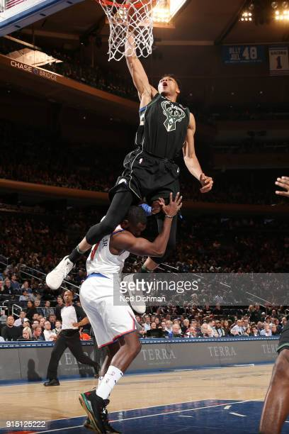 Giannis Antetokounmpo of the Milwaukee Bucks slams a dunk over Tim Hardaway Jr #3 of the New York Knicks during the game on February 6 2018 at...