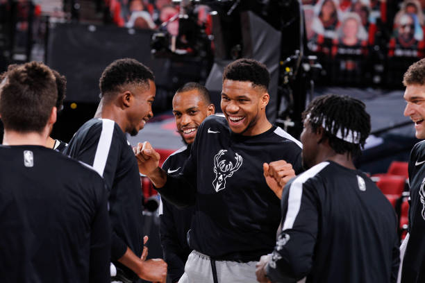 Giannis Antetokounmpo of the Milwaukee Bucks smiles before the game against the Portland Trail Blazers on April 2, 2021 at the Moda Center Arena in...