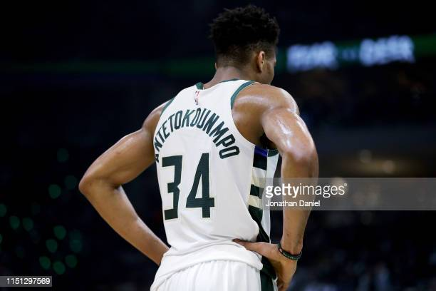 Giannis Antetokounmpo of the Milwaukee Bucks stands on the court in the second quarter against the Toronto Raptors during Game Five of the Eastern...