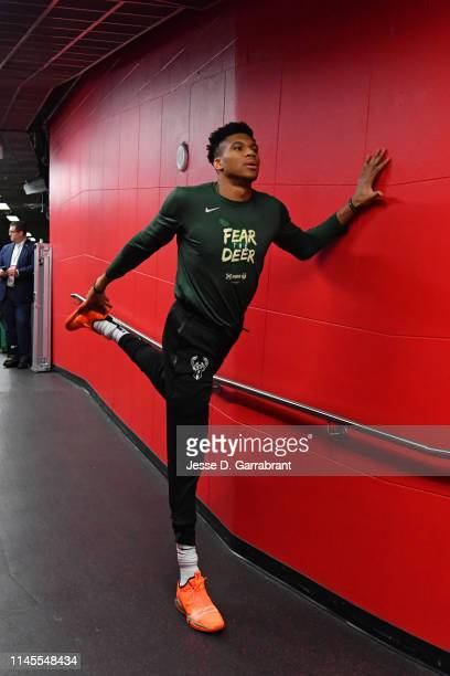 Giannis Antetokounmpo of the Milwaukee Bucks stretches against the Toronto Raptors during Game Four of the Eastern Conference Finals of the 2019 NBA...