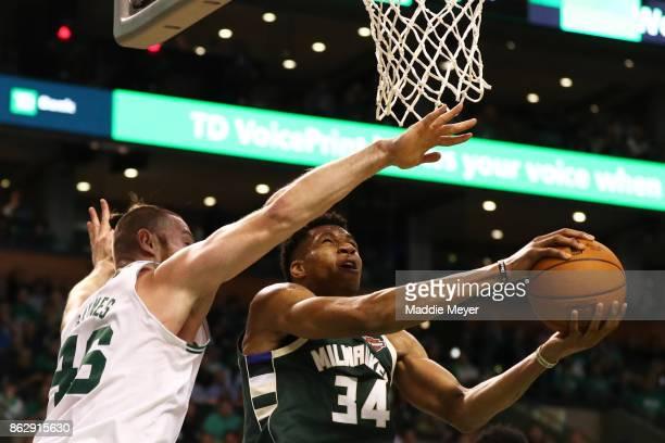 Giannis Antetokounmpo of the Milwaukee Bucks takes a shot against Aron Baynes of the Boston Celtics during the second quarter at TD Garden on October...