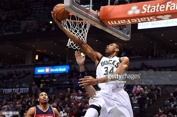 Giannis Antetokounmpo of the Milwaukee Bucks takes a shot during the first half of a game against the Washington Wizards at the BMO Harris Bradley...