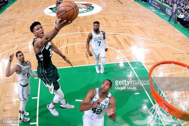 Giannis Antetokounmpo of the Milwaukee Bucks takes a shot over Al Horford of the Boston Celtics during the second half of Game 3 of the Eastern...