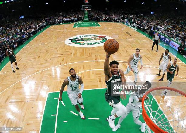 Giannis Antetokounmpo of the Milwaukee Bucks takes a shot over Jaylen Brown of the Boston Celtics during Game 4 of the Eastern Conference Semifinals...