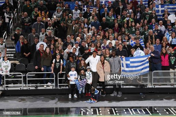 Giannis Antetokounmpo of the Milwaukee Bucks talks with fans after the game against the Charlotte Hornets on January 25 2019 at the Fiserv Forum...