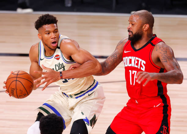 Giannis Antetokounmpo of the Milwaukee Bucks tangles with P.J. Tucker of the Houston Rockets at The Arena at ESPN Wide World Of Sports Complex on...