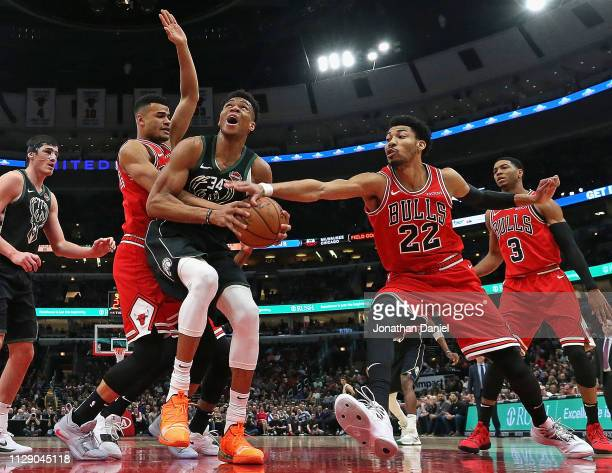 Giannis Antetokounmpo of the Milwaukee Bucks tries to get off a shot between Timothe LuwawuCabarrot and Otto Porter Jr #22 of the Chicago Bulls at...