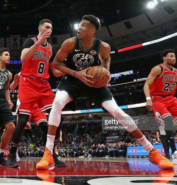 Giannis Antetokounmpo of the Milwaukee Bucks tries to get off a shot against Zach LaVine of the Chicago Bulls at the United Center on February 11...