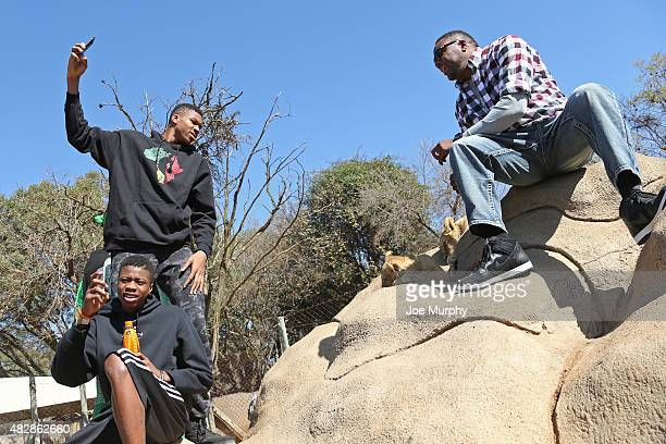 Giannis Antetokounmpo of the Milwaukee Bucks visits the South Africa Lion Park as part of Basketball Without Borders on August 2 2015 in Johannesburg...