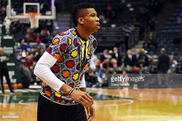 Giannis Antetokounmpo of the Milwaukee Bucks wears a shirt honoring the late Craig Sager during warmups prior to a game against the Chicago Bulls at...