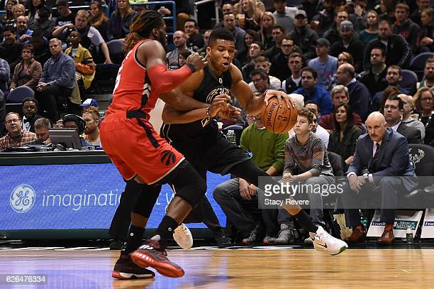 Giannis Antetokounmpo of the Milwaukee Bucks works against DeMarre Carroll of the Toronto Raptors during a game at the BMO Harris Bradley Center on...
