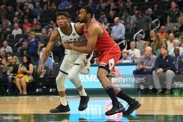 Giannis Antetokounmpo of the Milwaukee Bucks works against Jabari Parker of the Chicago Bulls during the first half of a preseason game at the Fiserv...