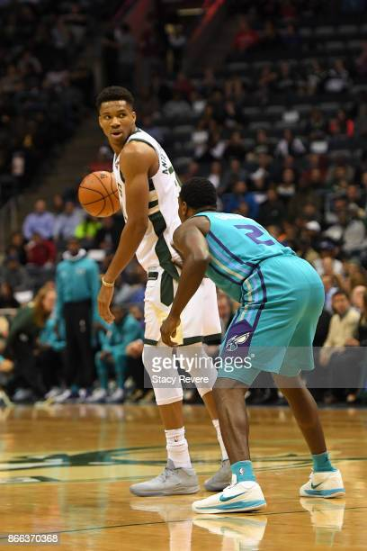 Giannis Antetokounmpo of the Milwaukee Bucks works against Treveon Graham of the Charlotte Hornets during a game at the BMO Harris Bradley Center on...