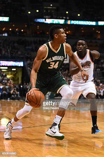 Giannis Antetokounmpo of the Milwaukee Bucks works against Victor Oladipo of the Oklahoma City Thunder during the first half of a game at the BMO...
