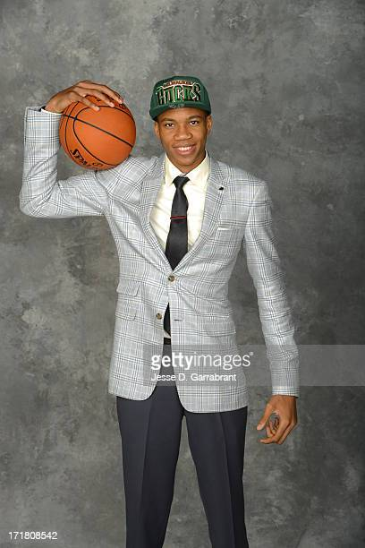 Giannis Antetokounmpo poses for a portrait after being selected during the 2013 NBA Draft at the Barclays Center on June 27 2013 in Brooklyn New York...