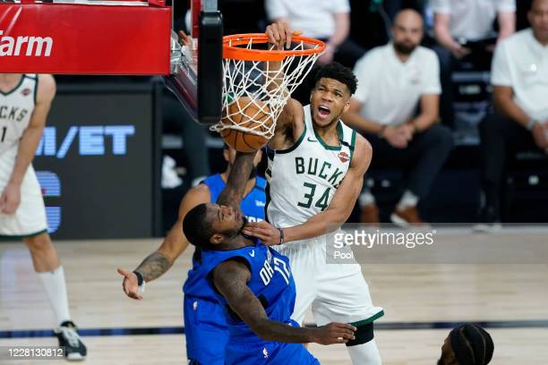 Giannis Antetokounmpo scores over Gary Clark of the Orlando Magic during the second half of an NBA basketball first round playoff game on August 20...
