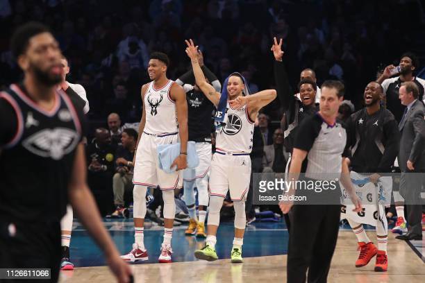 Giannis Antetokounmpo Stephen Curry Kyle Lowry and Kemba Walker of Team Giannis smile during the 2019 NBA AllStar Game on February 17 2019 at the...