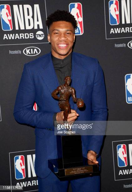 Giannis Antetokounmpo, winner of the Kia NBA Most Valuable Player award, poses in the press room during the 2019 NBA Awards presented by Kia on TNT...