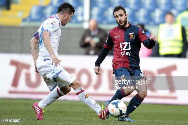 Giannis Fetfatzidis of Genoa CFC in action with Mariano Izco of Calcio Catania during the Serie A match between Genoa CFC and Calcio Catania at...