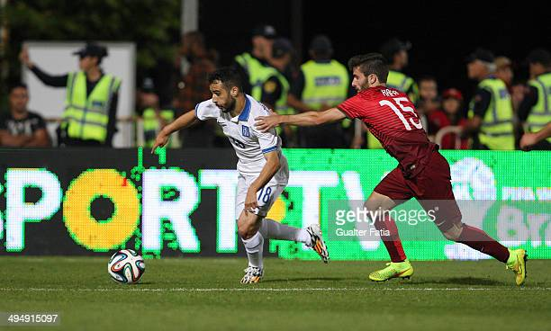 Giannis Fetfatzidis of Greece trying to escape Rafa of Portugal during the International Friendly between Portugal and Greece National Stadium on May...