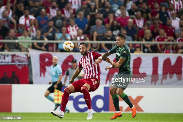 Giannis Fetfatzidis of Olympiacos vies with Sergio Leon of Betis during the UEFA Europa League Group F match between Olympiacos and Real Betis at...