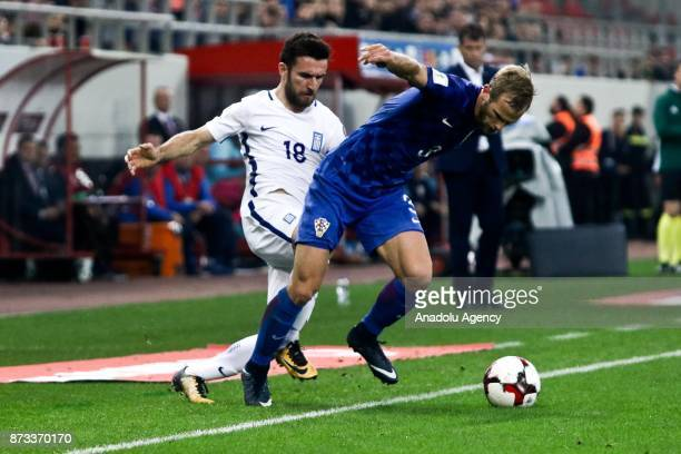 Giannis Gianniotas of Greece in action against Ivan Strinic of Croatia during the World Cup Russia 2018 European Qualifiers match between Greece and...