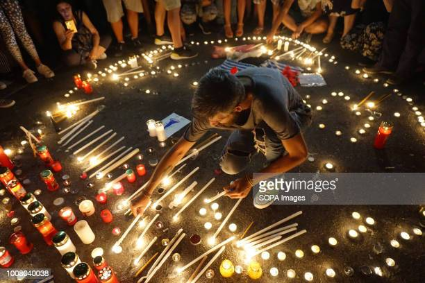 Giannis Gkakaloudis former player of Panathinaikos Basketball team lights a candle during a silent protest People gathered outside the Hellenic...