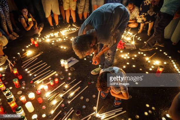 Giannis Gkakaloudis former player of Panathinaikos Basketball team seen with a kid during the vigil service People gathered outside the Hellenic...
