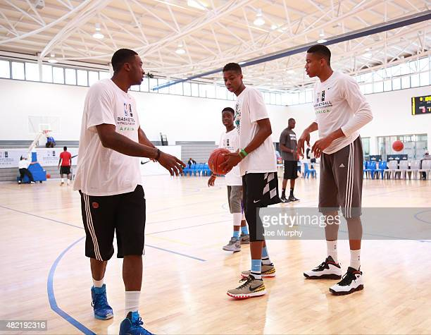Giannis Kostas Thanasis and Alex Antetokounmpo goes through some drill during a workout prior to the Basketball Without Boarders program on July 28...