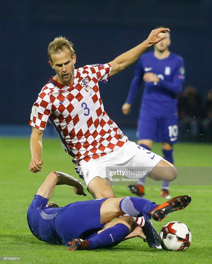 Giannis Maniatis (L) of Greece is challenged by Ivan Strinic (R) of Croatia during the FIFA 2018 World Cup Qualifier Play-Off: First Leg between Croatia and Greece at Stadion Maksimir on November 9, 2017 in Zagreb, Croatia