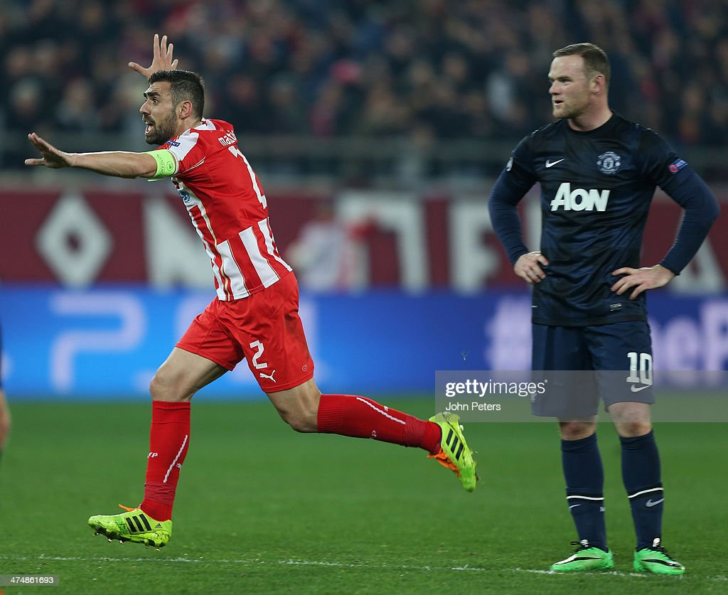 Giannis Maniatis of Olympiacos FC celebrates after his shot was deflected in by Alejandro Dominguez for their first goal during the UEFA Champions League Round of 16 match between Olympiacos FC and Manchester United at Karaiskakis Stadium on February 25, 2014 in Piraeus, Greece.