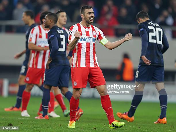 Giannis Maniatis of Olympiacos FC celebrates at the final whistle during the UEFA Champions League Round of 16 match between Olympiacos FC and...
