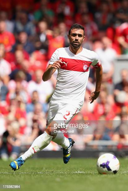 Giannis Maniatis of Olympiacos in action during the Steven Gerrard Testimonial Match between Liverpool and Olympiacos at Anfield on August 03 2013 in...