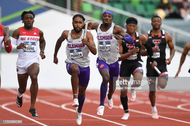 Giano Roberts and Markus Parker of the Clemson University Tigers compete in the 4 x 100 meter relay during the Division I Men's and Women's Outdoor...