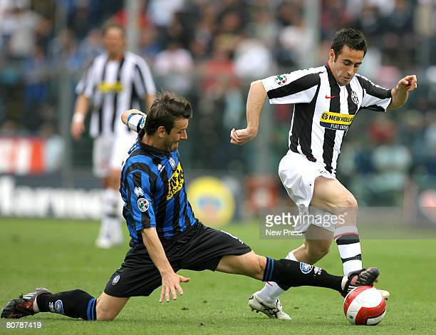 Gianpaolo Bellini of Atalanta and Marco Marchionni of Juventus in action during the Serie A match between Atalanta and Juventus at the Stadio Azzurri...