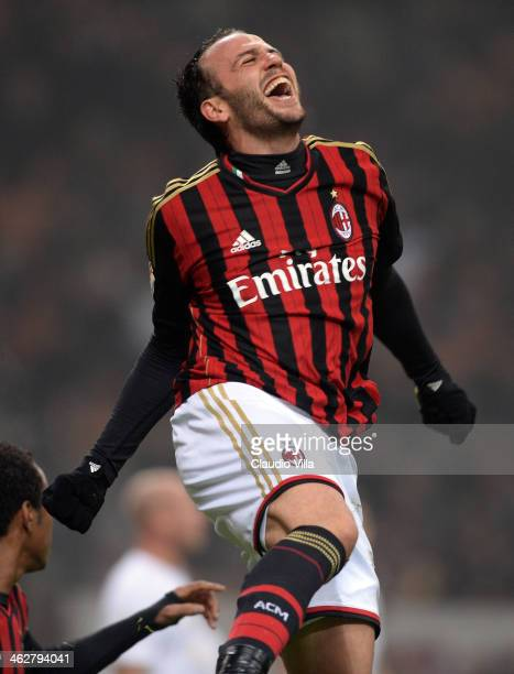 Gianpaolo Pazzini of AC Milan celebrates scoring the second goal during the TIM Cup match between AC Milan and AC Spezia at San Siro Stadium on...