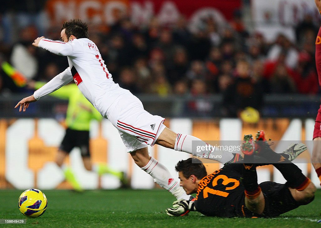 GianPaolo Pazzini (L) of AC Milan is fouled by AS Roma goalkeeper Mauro Goicoechea to receive a penalty during the Serie A match between AS Roma and AC Milan at Stadio Olimpico on December 22, 2012 in Rome, Italy.