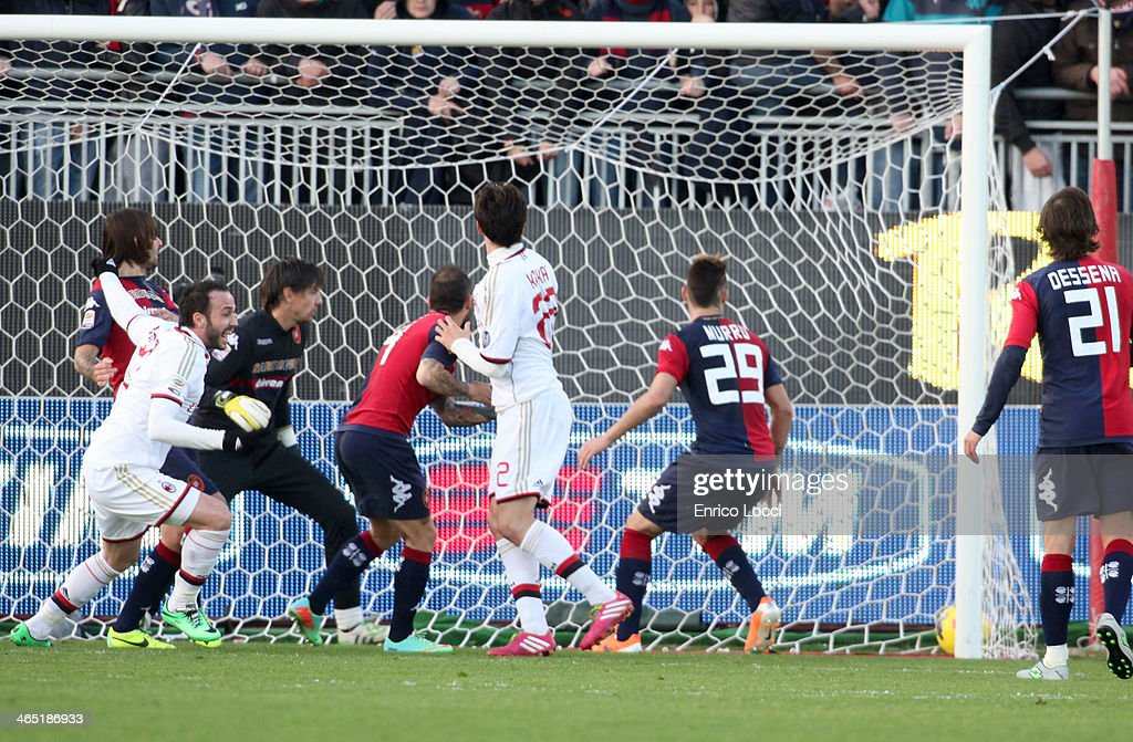 Gianpaolo Pazzini (L) of Milan scores the winning goal during the Serie A match between Cagliari Calcio and AC Milan at Stadio Sant'Elia on January 26, 2014 in Cagliari, Italy.