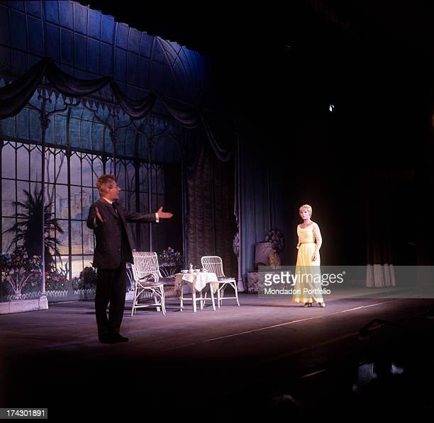 Gianrico Tedeschi playing the role of professor Higgins who after having taken under his wing the flower girl Eliza Doolittle and having turned her...