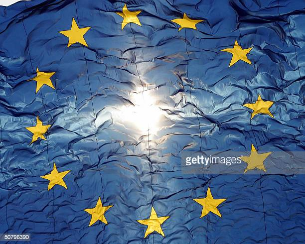 A giant 150 square meter European flag flies 01 May 2004 during a celebration at the Brussels Jubilee Park to mark the expansion of the European...