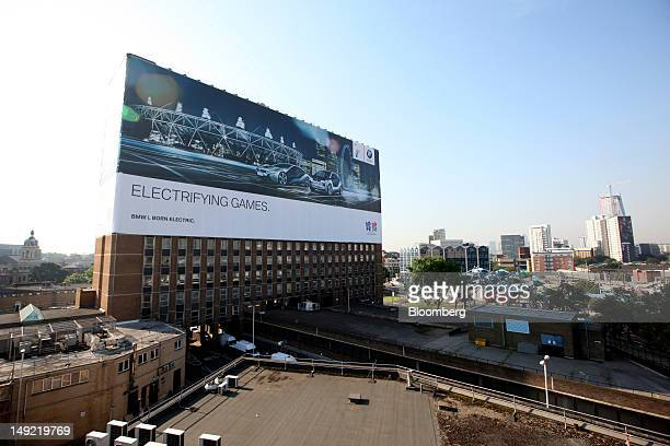 A giant advert for Bayerische Motoren Werke AG's new 'I' subbrand of electric vehicles covers the side of a building next to the Olympic Park in...